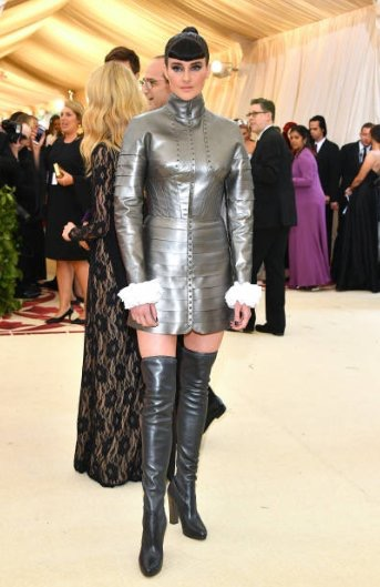 Shailene Woodley makes a nod to Joan of Arc on the red carpet at the 2018 met gala in a silver armoured tunic and thigh high boots